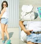 Jeansowe szorty, biały plecak i zielone New Balance'y