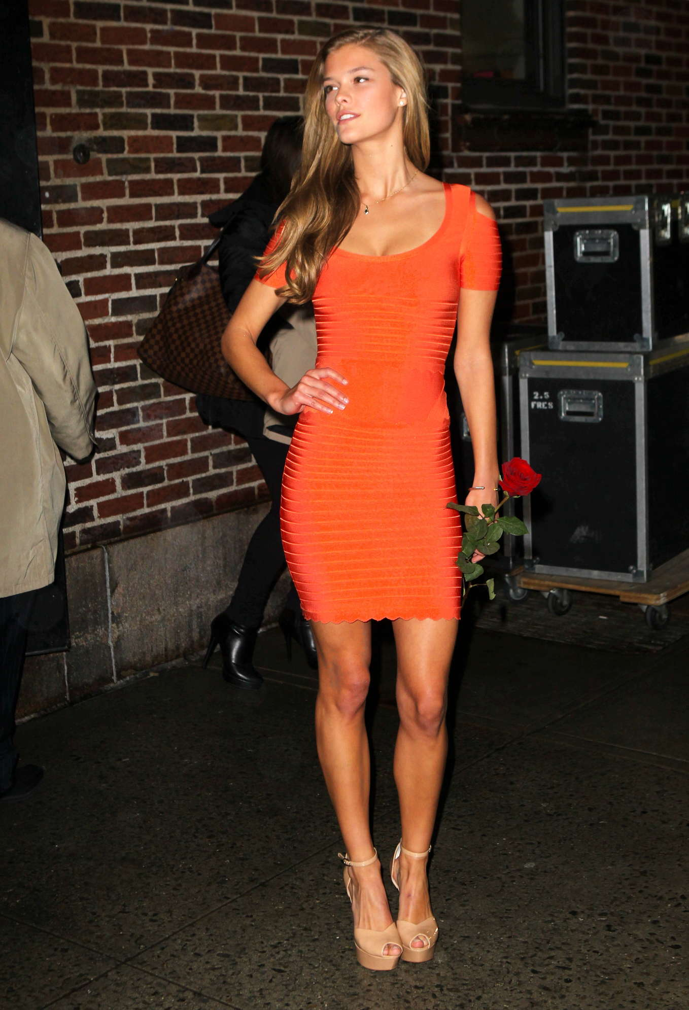 Nina-Agdal-In-Orange-Dress--02